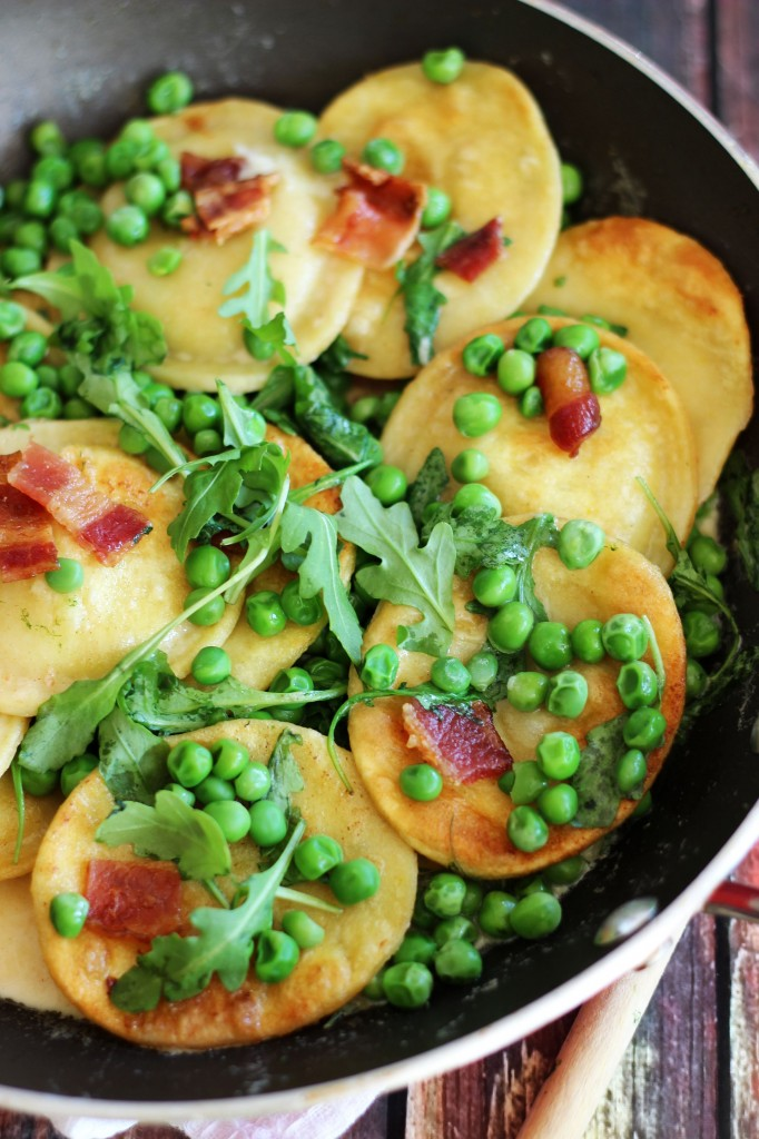 seared ravioli with bacon peas arugula and butter cream sauce 9