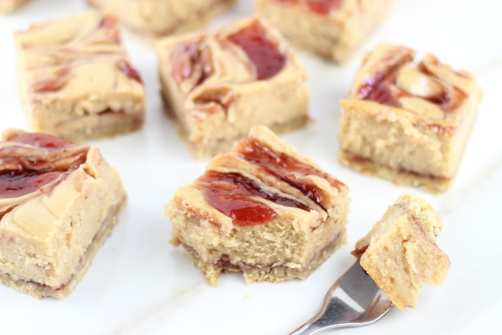 peanut butter & jelly swirl cheesecake bars 14