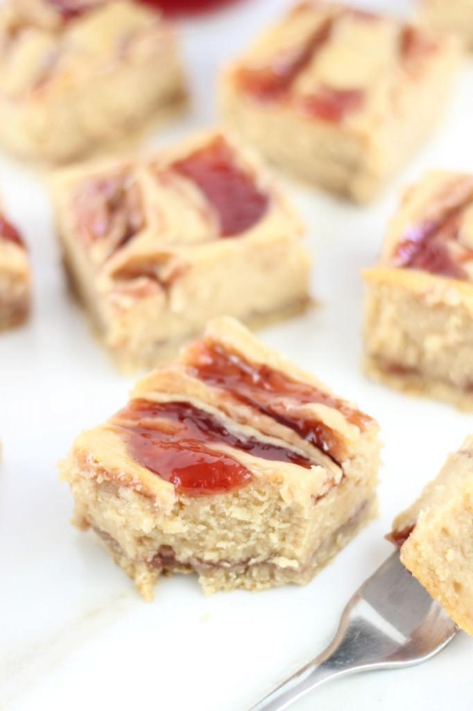 peanut butter & jelly swirl cheesecake bars 16