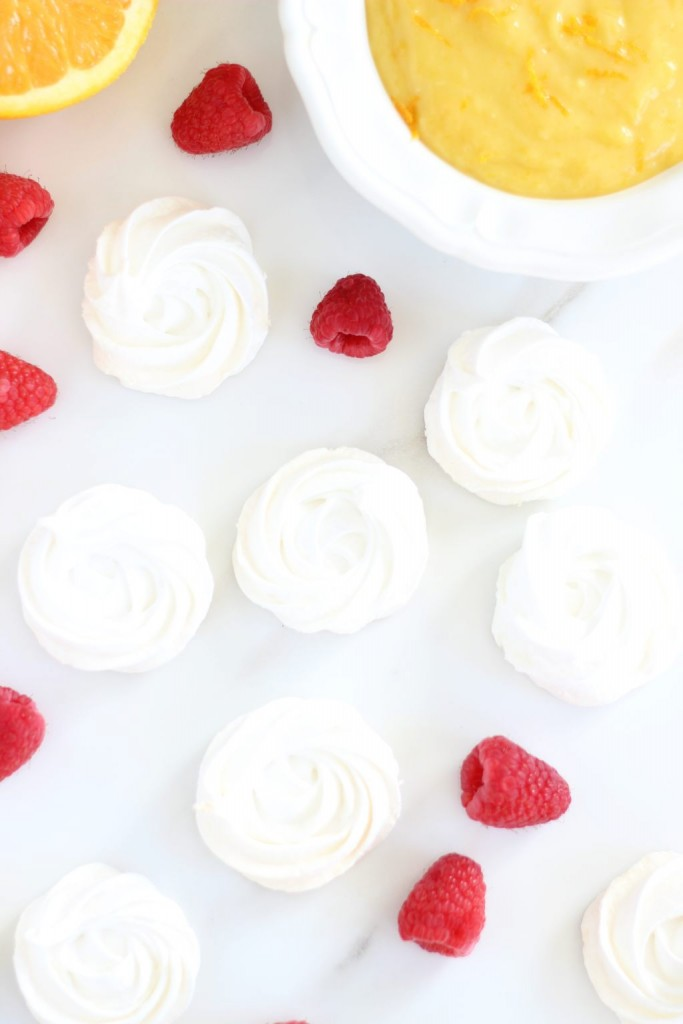 meringue nests with orange curd and raspberries 5