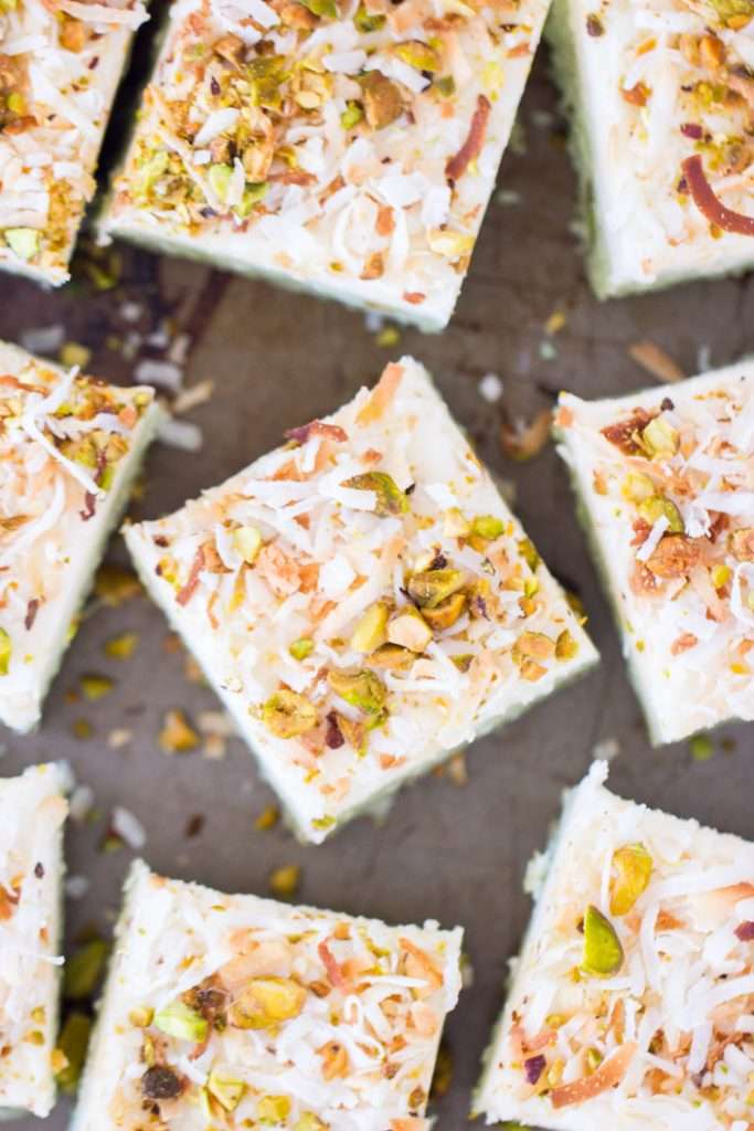 Coconut Pistachio Bars with Coconut Cream Cheese Frosting recipe image thegoldlininggirl.com 4